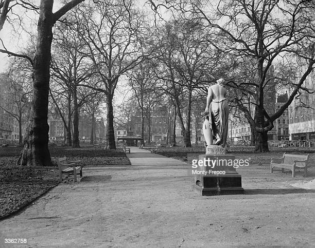 Berkeley Square in London in the process of being reseeded and cleaned by Westminster City Council