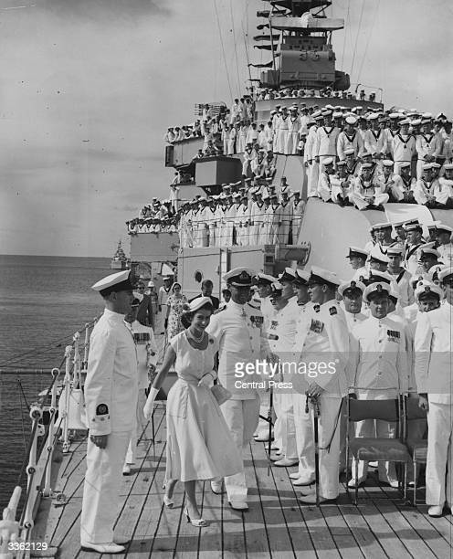 Queen Elizabeth II and Prince Philip Duke of Edinburgh on board HMAS Australia at sea off Townsville Queensland during a royal tour of Australia...