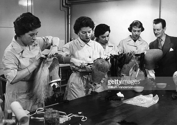 Trainee hairdressers Susan Shepherd of Whitton Maureen Richard of London Pamela Wright of Leeds and Jill Blackwood of St Annes on Sea practice some...
