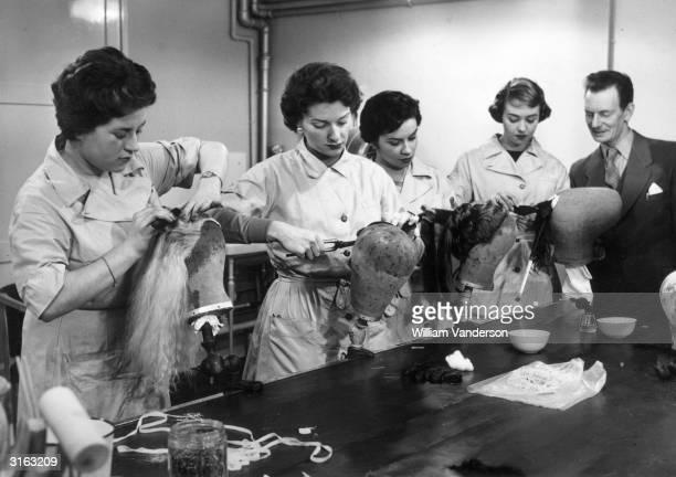 Trainee hairdressers Susan Shepherd of Whitton, Maureen Richard of London, Pamela Wright of Leeds and Jill Blackwood of St Annes on Sea practice some...
