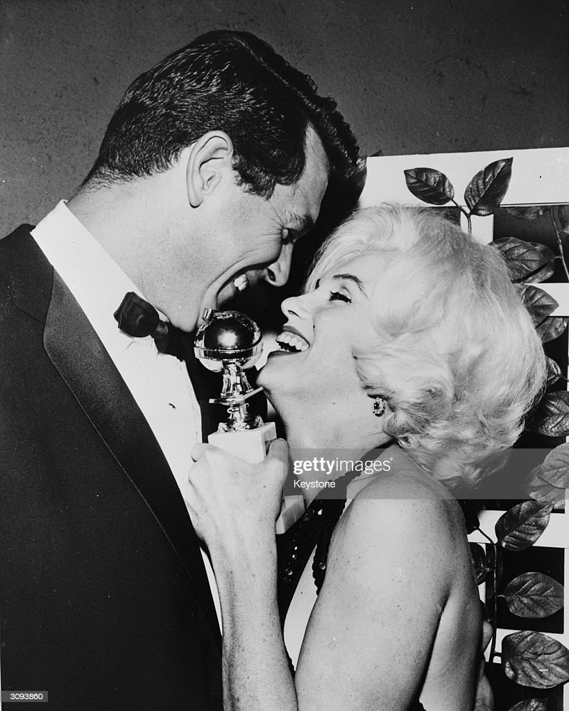Marilyn Monroe (Norma Jean Mortenson or Norma Jean Baker, 1926 - 1962) receives her Golden Globe award from Rock Hudson (1925 - 1985) at the Hollywood Foreign Press Association's 19th Annual Dinner.