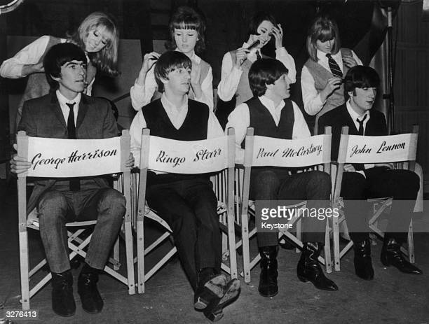 The Beatles from left to right George Harrison Ringo Starr Paul McCartney and John Lennon have their famous hairdos tidied up before going on to the...