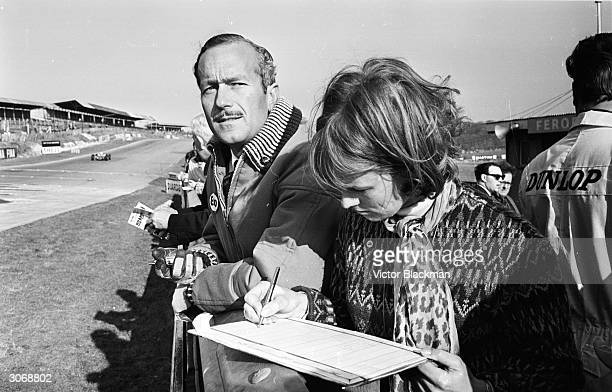 British racing driver and car designer Colin Chapman the founder of Lotus at the Brands Hatch track in Kent