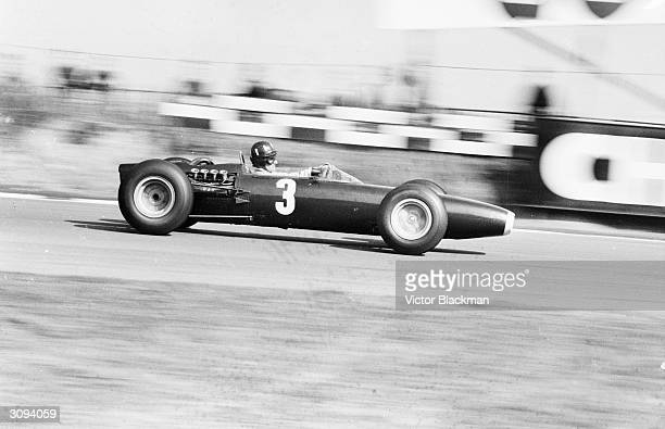 British racing driver Graham Hill winner of 14 World Championship races takes part in a race at Brands Hatch Kent