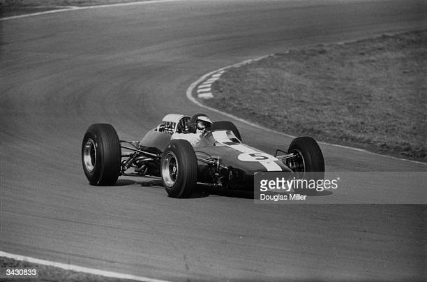 Scottish racing driver Jim Clark in the 212 mile 'Race of Champions ' held at Brands Hatch He is driving a LotusCoventry Climax and went on to win...