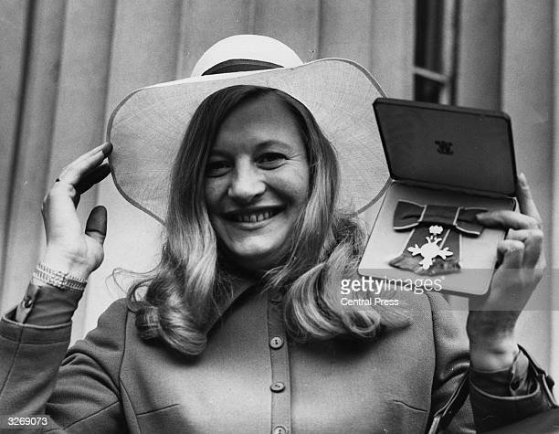 Irish athlete Mary Elizabeth Peters winner of a gold medal for Britain in the Pentathlon event of the 1972 Munich Olympics displays here MBE...
