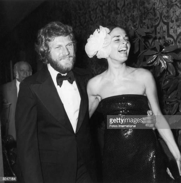 Married American actors Steve McQueen and Ali MacGraw attend the American Film Institute ceremony honoring actor James Cagney with its Life...