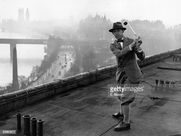 American golfer Francis Ouimet practising for the Walker Cup match against Great Britain on the roof of the Savoy Hotel, London.