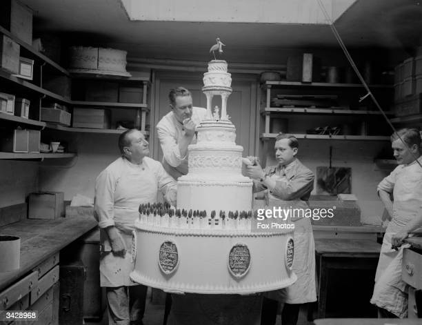 Bakers putting the finishing touches to a giant cake created for Queen Charlotte's birthday