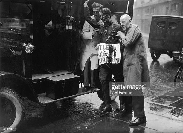 The wax model of Hitler exhibited in Madame Tussaud's in London being taken to Marylebone Police court as evidence used towards the conviction of...