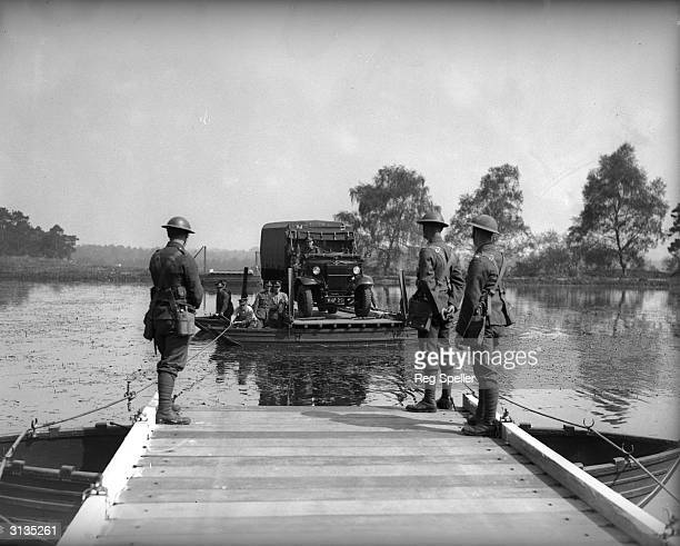 Men of the Royal Engineers and the 2nd Battalion Wiltshire Regiment demonstrate the latest type of pontoon for carrying heavy vehicles at Eelmoor...