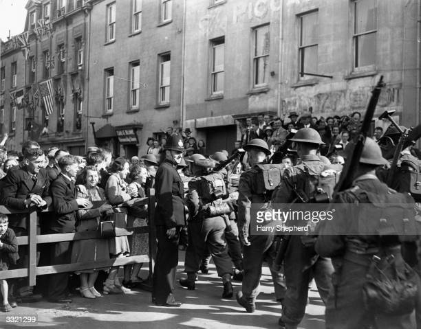 Crowds welcome British troops on Jersey during the liberation of the Channel Islands