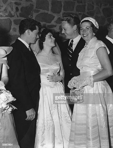Screen star Van Johnson and his wife Evie congratulate Elizabeth Taylor and her husband Conrad Hilton at their wedding reception in Beverly Hills...