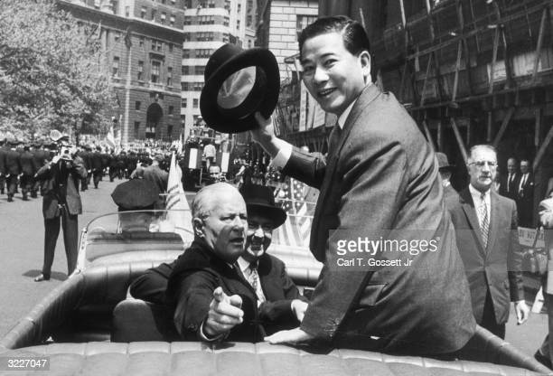 South Vietnamese President Ngo Dinh Diem greets the crowd as he rides with Commissioner Richard Patterson and Chief Protocol of the State Department...