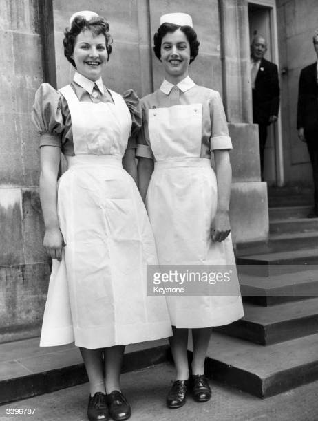 Staff nurse Cisca Ransom wearing the present day nursing uniform and Sister Sheila Spark with the new indoor uniform both worn with aprons