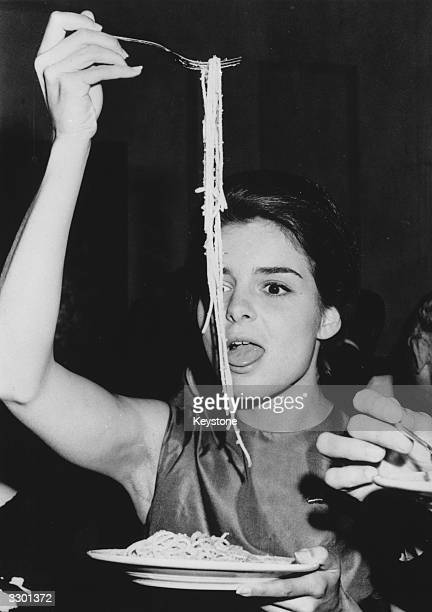 Heiress Sylvia Casablancas enjoying a portion of spaghetti at a party given by French photographer Louis Dalmas during the International Film...