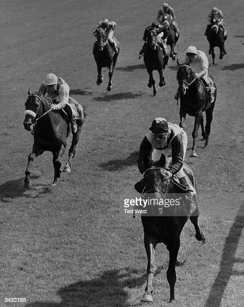 The racehorse 'Black Prince II' about to cross the finishing line during the Carreras Piccadilly Derby Trial Stakes at Lingfield Park