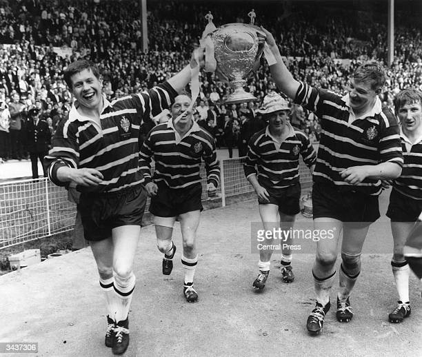 Featherstone Rovers captain Malcolm Dixon holds the Rugby League Cup aloft with the help of a team mate after they had beaten Barrow at Wembley...