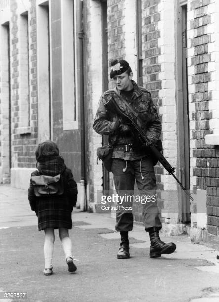 A Belfast girl chats to a soldier out patrolling the streets in the Falls Road area