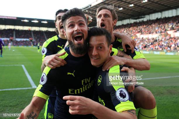 13th May 2017 - Premier League - Stoke City v Arsenal - Mesut Ozil of Arsenal celebrates with teammates Olivier Giroud of Arsenal , Hector Bellerin...