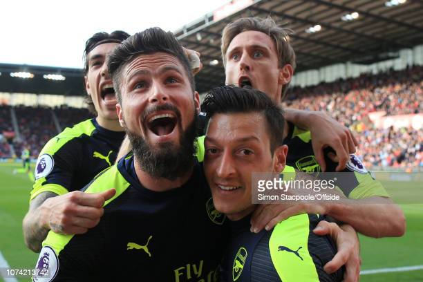 13th May 2017 - Premier League - Stoke City v Arsenal - Mesut Ozil of Arsenal celebrates with teammates Olivier Giroud , Hector Bellerin and Nacho...