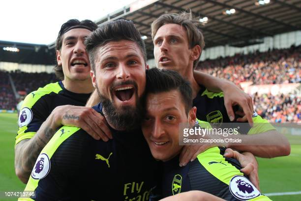 13th May 2017 - Premier League - Stoke City v Arsenal - Mesut Ozil of Arsenal celebrates with teammates Olivier Giroudl , Hector Bellerin and Nacho...