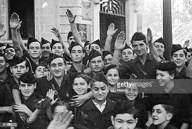 Fascist youth both boys and girls in the rebel uniforms in Irun after the city had been captured by the rebels