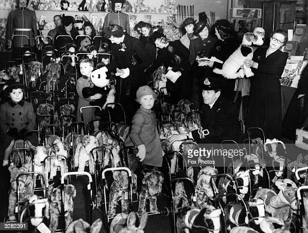Children choosing toy animals for Christmas at Harrods Christmas show during wartime austerity