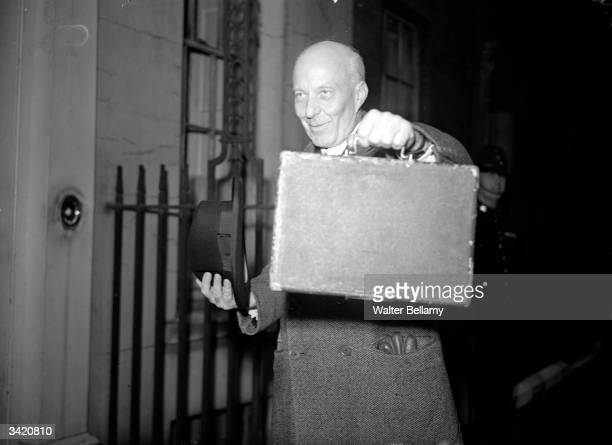 British Labour politician and Chancellor of the Exchequer Hugh Dalton carrying the budget box He later resigned as Chancellor after a small budget...