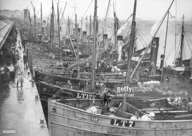 Drifters unload their fish at Lowestoft With the Herring season in full swing the boats keep the steam up as once unload they will immediately set...