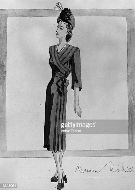 Norman Hartnell's sketch of Princess Elizabeth's going-away dress. The dress is love-in-the-mist blue crepe with cross-over bodice draped to the left...