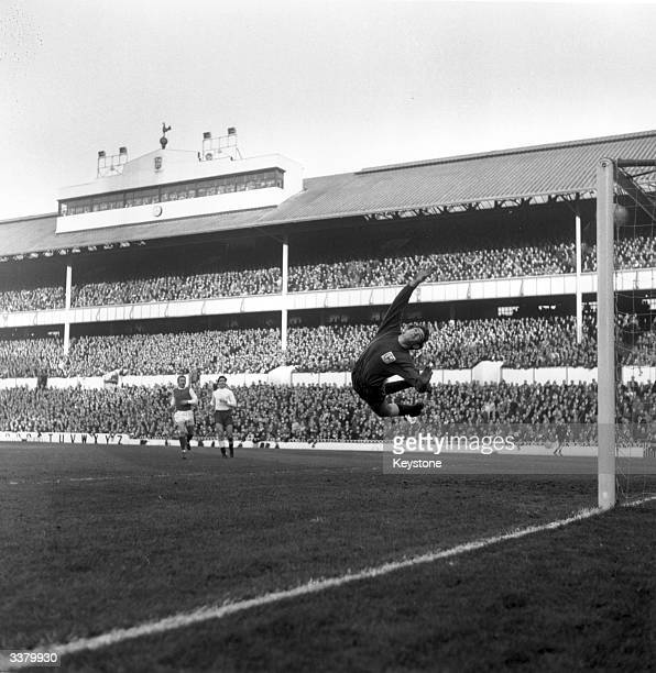 Tottenham Hotspur goalkeeper Pat Jennings makes a brave attempt to save a Sheffield Wednesday goal at White Hart Lane