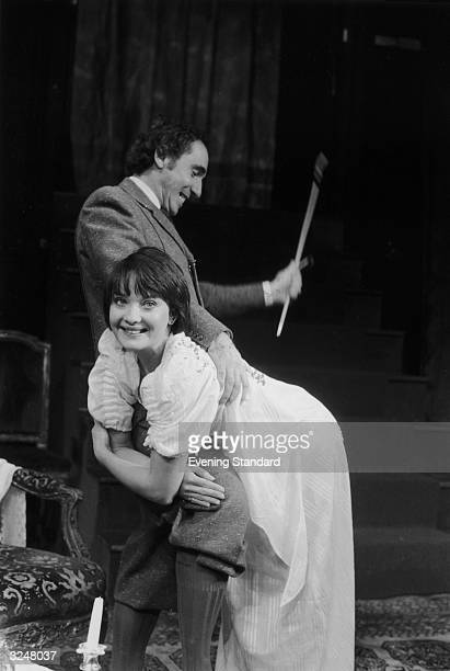 Actors Nigel Hawthorn and Nicola Pagett enjoy a spot of corporal punishment in a production of dThe Ride Across Lake Constancef by Peter Handke at...