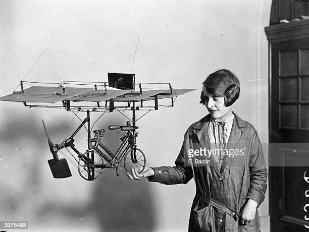 A visitor admires an ordinary pedal cycle fitted with wings and a few special accessories that will fly which is one of the inventions in an...