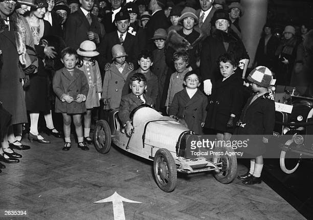 Young Donald Campbell shows off a replica of his father Malcolm's racing car, an electric Bugatti, at the Children's Motor Show in Selfridges,...