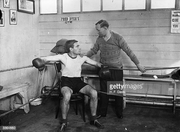 Former world flyweight boxing champion Jimmy Wilde giving his son David Wilde some expert advice during training at the gymnasium in Chancery Lane...