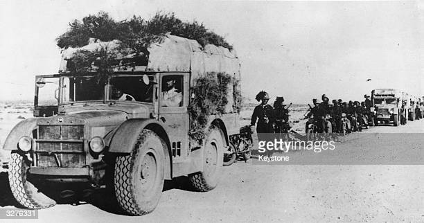 A column of Italian troops headed by a camouflaged lorry during their advance on to El Solum