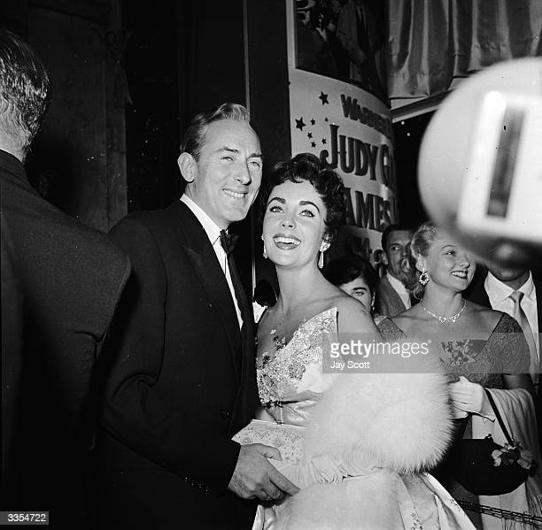 Actress Elizabeth Taylor with husband Michael Wilding at the film premiere of 'A Star Is Born', starring Judy Garland.