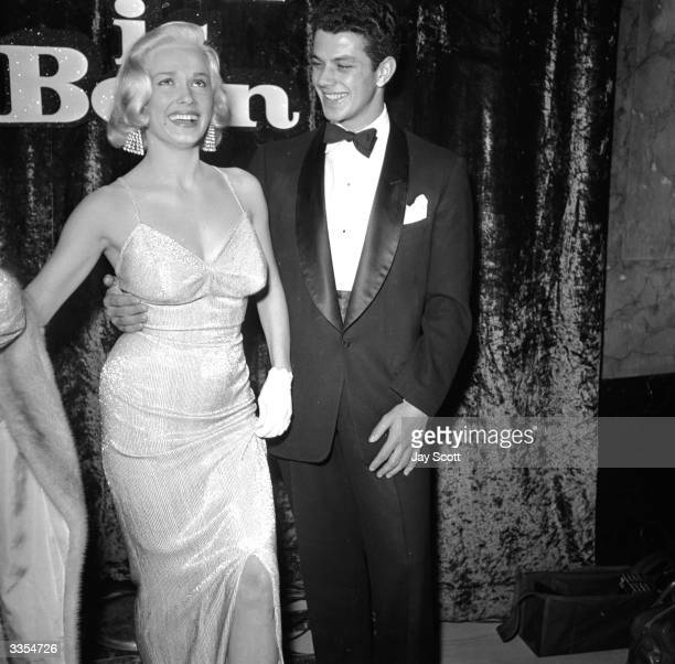American actress Mamie van Doren with Kevin Delroy at the film premiere of 'A Star Is Born', starring Judy Garland.