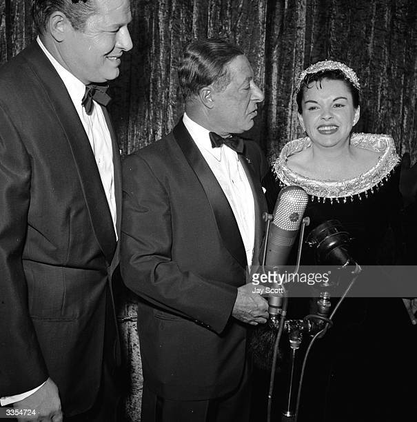 Award winning American actress Judy Garland with actor Jack Carson and George Jesel at her film premiere for 'A Star Is Born'.