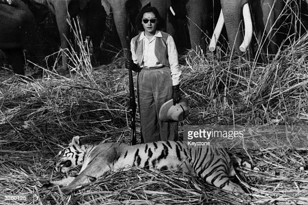 Queen Ratna Rajya Lakshmi Devi wife of King Mahendra of Nepal with a tiger she shot during a big game hunt in the jungle