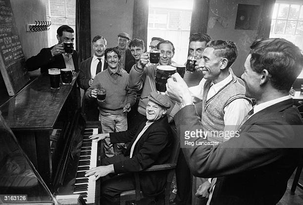 A group of men from the Atlantic Island of Tristan da Cunha gather for a pint and a singsong at the local before leaving England
