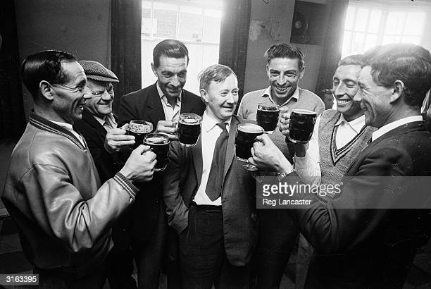 A group of men from the Atlantic Island of Tristan da Cunha gather for a pint at the local before leaving England