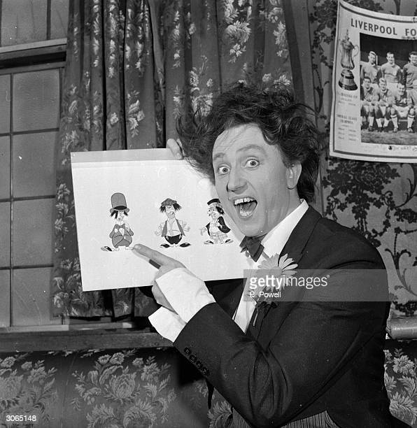 Liverpudlian comedian Ken Dodd star of 'Doddy's Here' with some cartoons of his 'Diddymen'