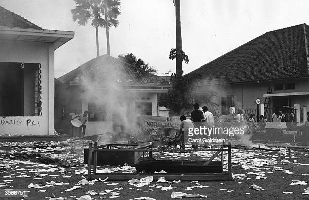 Muslim students in Jakarta Indonesia burning the headquarters of the Communist Youth Organisation following an aborted communist coup
