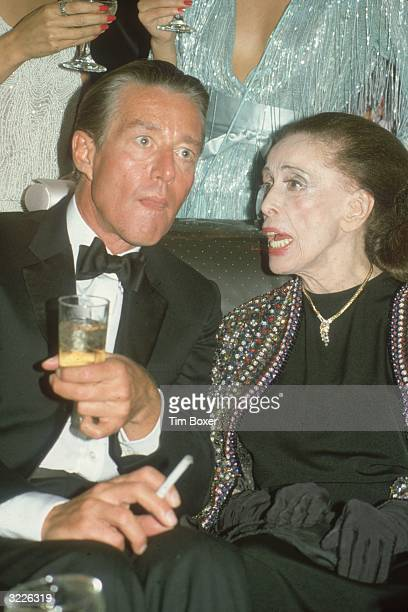 Fashion designer Halston, , listens to modern dance choreographer Martha Graham at a party held in her honour at Studio 54, a nightclub in New York...