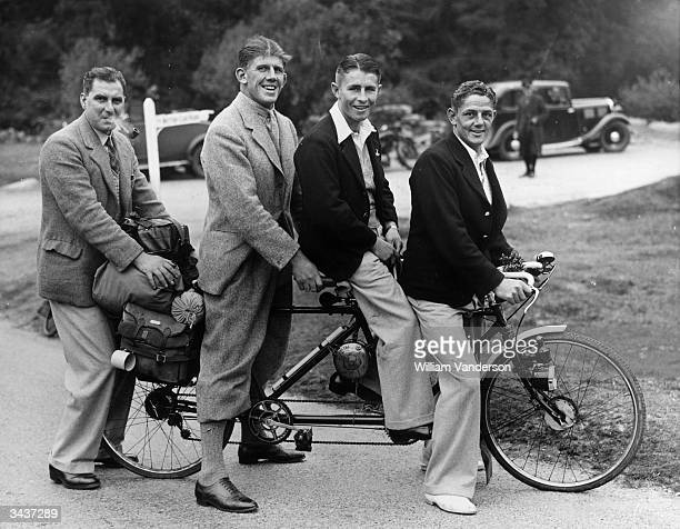 Members of the New Zealand Rugby Union team the 'All Blacks' riding a cycle made for two during their stay at Newton Abbot in Devon.