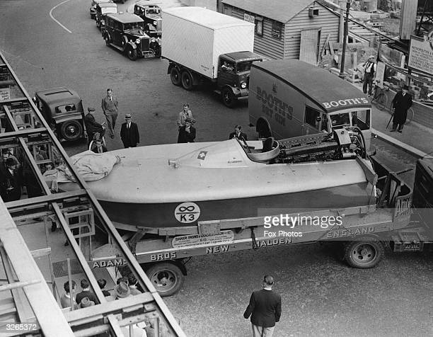 Sir Malcolm Campbell's record breaking boat Bluebird holds up traffic in the Finchley Road London