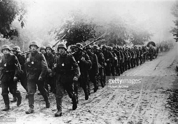 German troops marching through the Polish mud to the front lines
