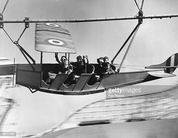 Young evacuees from Manchester and Salford enjoying themselves on the aeroplane ride pretending to bomb Berlin at Blackpool pleasure beach